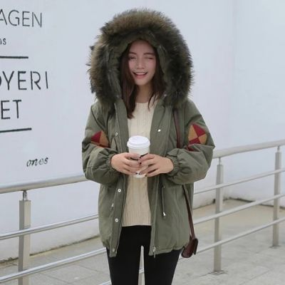 Winter coat for women with geometric embroidery and fur hood