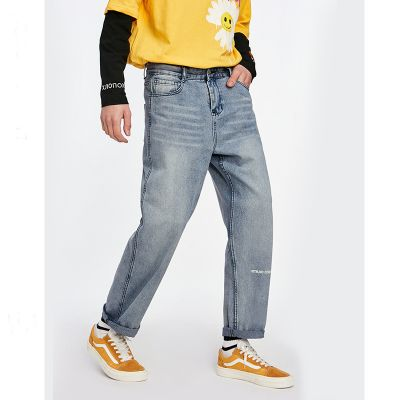 Straight leg jeans in mid wash blue for men