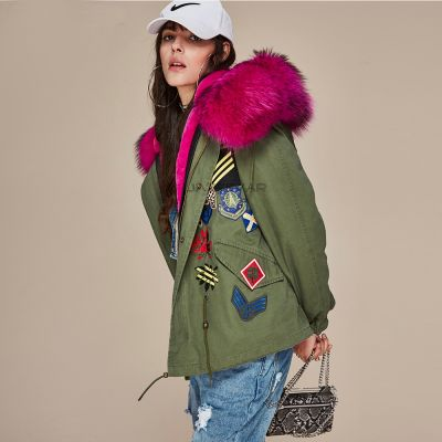 Women winter coat with embroidered badges and fur hood