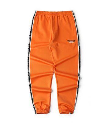 Orange sweatpants with black side trim retro sportswear for men