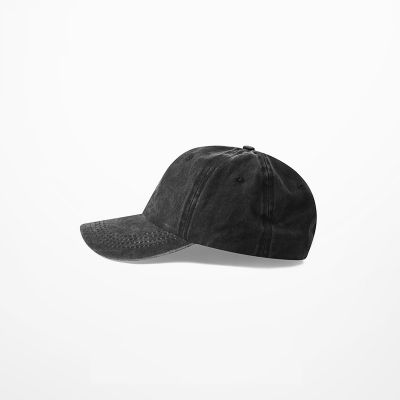 Black baseball cap aged denim jeans faded effect