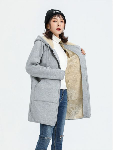 Thick winter coat for women with faux fur hood.